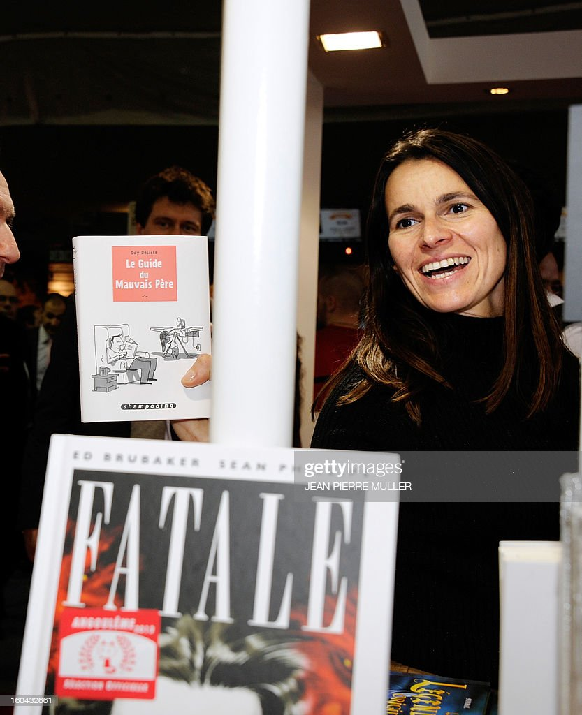 French Culture Minister Aurelie Filippetti visits the 40th International Comic book festival of Angouleme on January 31, 2013.