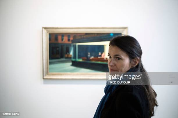French Culture Minister Aurelie Filippetti visits the Edward Hopper exhibition at the Grand Palais with people beneficiaries of charity organizations...