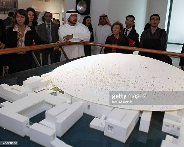 French Culture Minister Christine Albanel looks at a model of the Louvre museum in the Emirati capital of Abu Dhabi 07 January 2008 Agence...