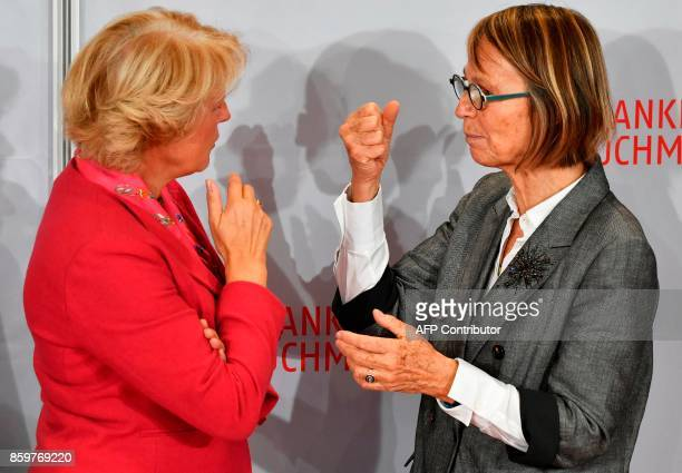 French Culture Minister Francoise Nyssen and Germany's minister of Culture Monika Gruetters gesture as they arrive for the opening of the Frankfurt...