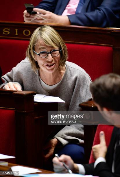 French Culture Minister Francoise Nyssen laughs during a session of questions to the government at the National Assembly in Paris on November 15 2017...