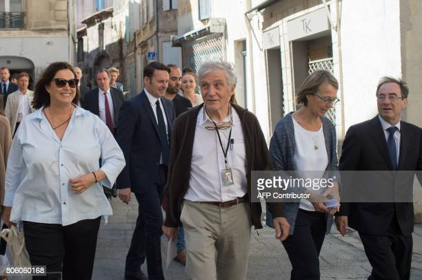 French Culture Minister Francoise Nyssen walks next to her husband JeanPaul Capitani Swiss art patron and founder of the LUMA foundation Maja...