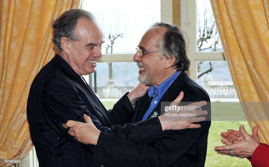 French Culture Minister Frederic Mitterrand (L) congratulates US cartoons' scenarist Art Spiegelman after awarding him Officier de l'ordre des Arts et des Lettres (French cultural award) after a visit at the 39th edition of Angouleme world comic strip festival, on January 29, 2012 in Angouleme, southwestern France.