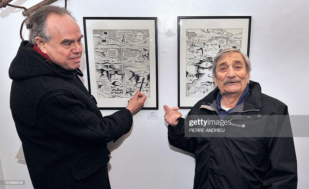 French Culture Minister Frederic Mitterrand (L) looks at works of French cartoonist Fred aka Frederic Othon during a visit at the 39th edition of Angouleme world comic strip festival, on January 29, 2012 in Angouleme, southwestern France.AFP PHOTO / PIERRE ANDRIEU