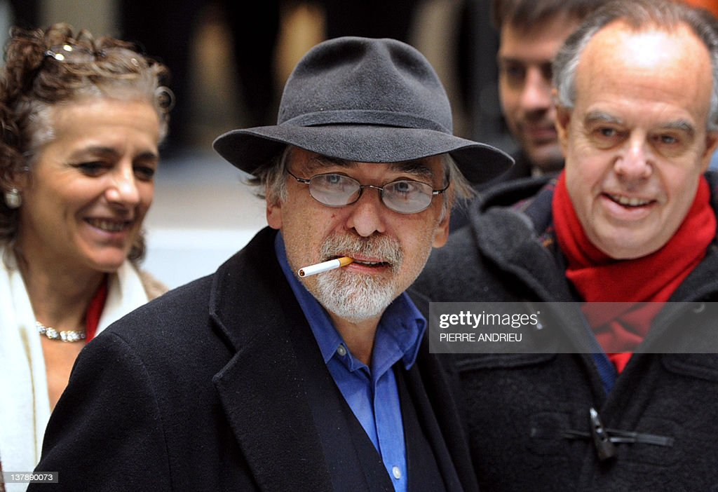 French Culture Minister Frederic Mitterrand (R) speaks with US cartoons' scenarist Art Spiegelman (C) and his wife Françoise Mouly (L) as he visits the 39th edition of Angouleme world comic strip festival, on January 29, 2012 in Angouleme, southwestern France.