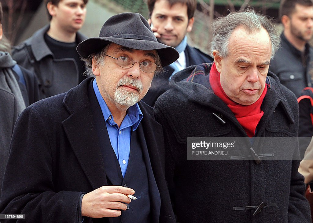 French Culture Minister Frederic Mitterrand (R) walks with US cartoons' scenarist Art Spiegelman after visiting the 39th edition of Angouleme world comic strip festival, on January 29, 2012 in Angouleme, southwestern France.AFP PHOTO / PIERRE ANDRIEU