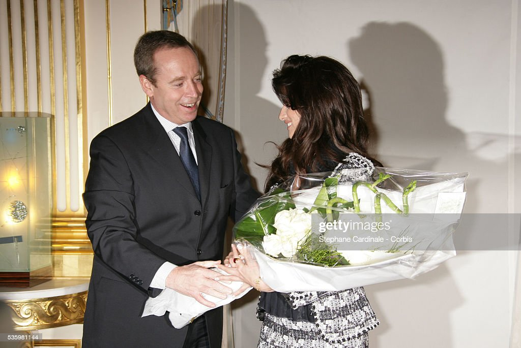 French Culture Minister, Renaud Donnedieu de Vabres, with actress Penelope Cruz who is being honoured with the medal of 'Chevalier des Arts et Lettres'.