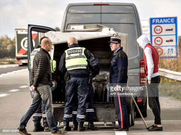 French customs officers conduct investigations and searches on a pickup and its driver on the highway A27 during a French and Belgian bilateral...