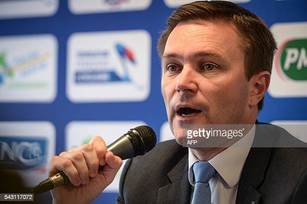 French cycling association President David Lappartient delivers a speech as he takes part to a press confereence during the 2016 French cycling...