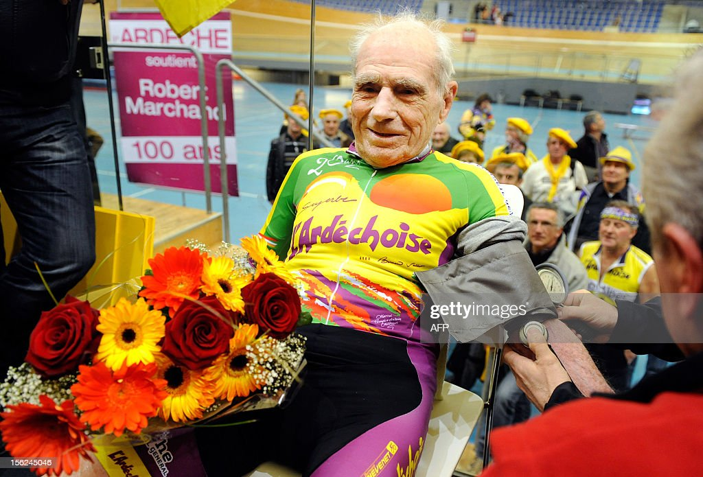 French cycling enthusiast and centenarian Robert Marchand,in France,has his blood pressure checked after setting a new record in the Master 100 years category on the track of the International Union Cycling on February 17, 2012 in Aigle. Born on November 26, 1911 Marchand rode 24.25 km (15.1 miles) in 60 minutes watched by crowds of cheering supporters at the International Cycling Union (UCI) velodrome .