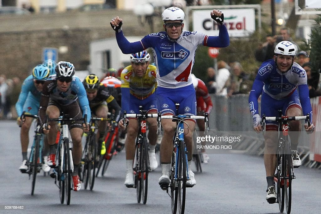 French cyclist Arnaud Demare (C) crosses the finish line to win the second stage of the La Méditerranéenne race in Port-Vendres on February 12, 2016. / AFP / RAYMOND ROIG