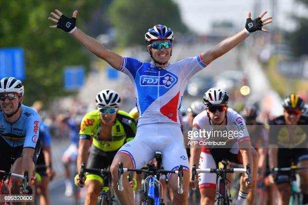 French cyclist Arnaud Demare of FDJ celebrates on the finish line after winning the 70th edition of the HalleIngooigem cycling race a UCI 11 2005km...