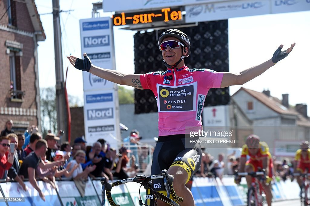 French cyclist Bryan Coquard of team Direct Energie celebrates after crossing the finish line, at the end of the third stage of the 'Quatre Jours de Dunkerque' (Four Days of Dunkirk) cycling race on May 6, 2016 in the French northern city of Saint-Pol-sur-Ternoise. PRESTI