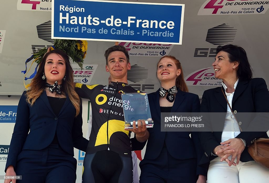 French cyclist Bryan Coquard of team Direct Energie celebrates on the podium after winning the third stage of the 'Quatre Jours de Dunkerque' (Four Days of Dunkirk) cycling race on May 6, 2016 in the French northern city of Saint-Pol-sur-Ternoise. PRESTI