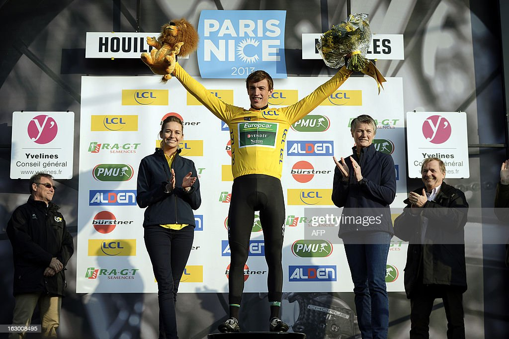 French cyclist Damien Gaudin (C) of Team Europcar celebrates wearing the leader Yellow Jersey on March 3, 2013 in Houilles, after winning the first stage of the 71st edition of the Paris-Nice cycling race.