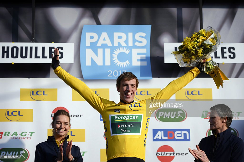 French cyclist Damien Gaudin (C) of Team Europcar celebrates wearing the leader Yellow Jersey on March 3, 2013 in Houilles, after winning the first stage of the 71st edition of the Paris-Nice cycling race. AFP PHOTO / JEFF PACHOUD