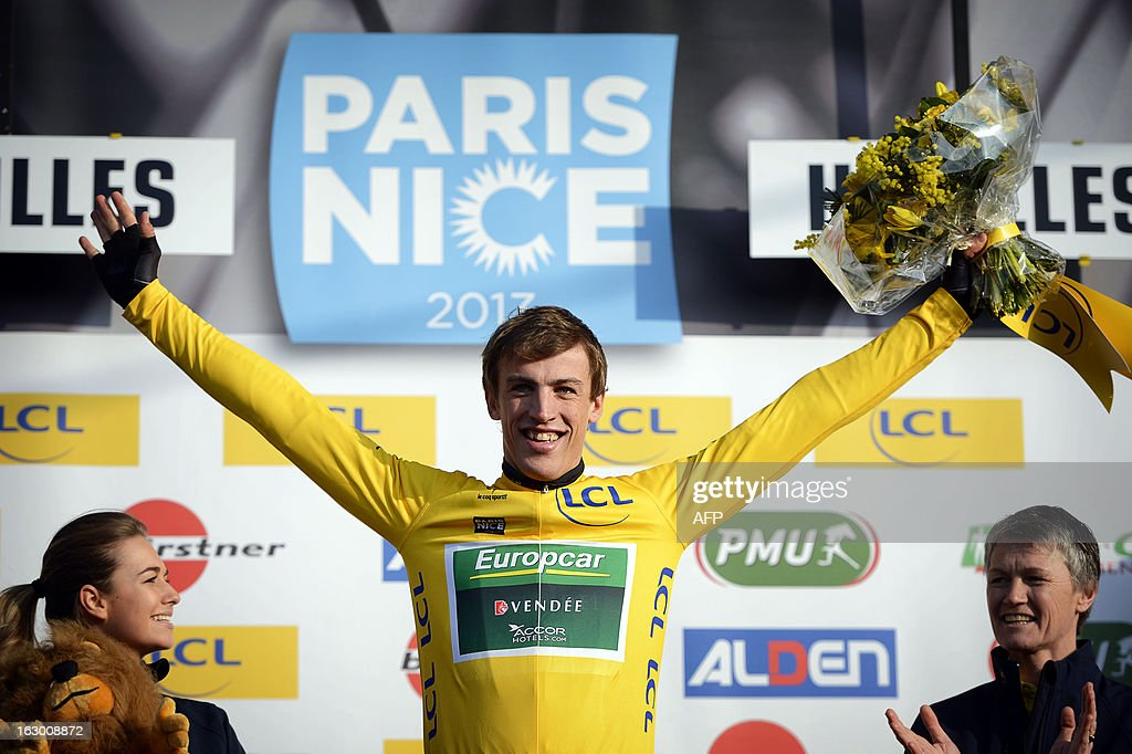 French cyclist Damien Gaudin of Team Europcar celebrates wearing the leader Yellow Jersey on March 3, 2013 in Houilles, after winning the first stage of the 71st edition of The Paris-Nice cycling race. AFP PHOTO / JEFF PACHOUD