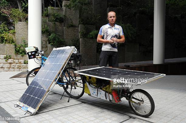 French Cyclist Florian Bailly Presents His Solar Electric Bike In Tokyo Japan On October 08 2010 Florian Bailly an adventurous cyclist who rode 10000...