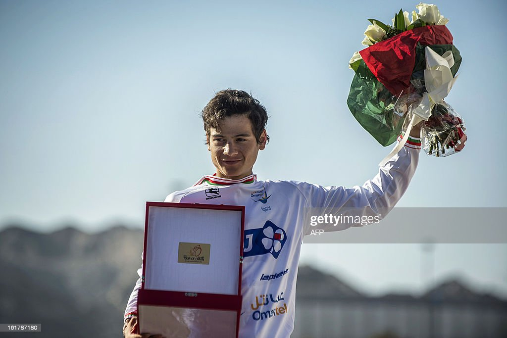 French cyclist of FDJ team Kenny Elissande celebrates on the podium after receiving the best young's white jersey at the end of the sixth and last stage of the cycling Tour of Oman, on February 16, 2013, in the Omani capital Muscat. The final stage was a 144km ride from Hawit Nagam park in the south of the emirate to Muscat along the Matrah corniche.
