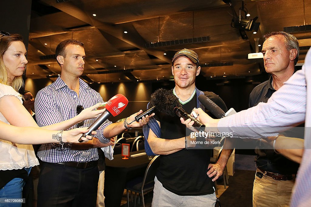 French cyclist Thomas Voeckler of Team Europcar speaks to media at a press conference with his shoulder in a sling after he broke his collar bone on...