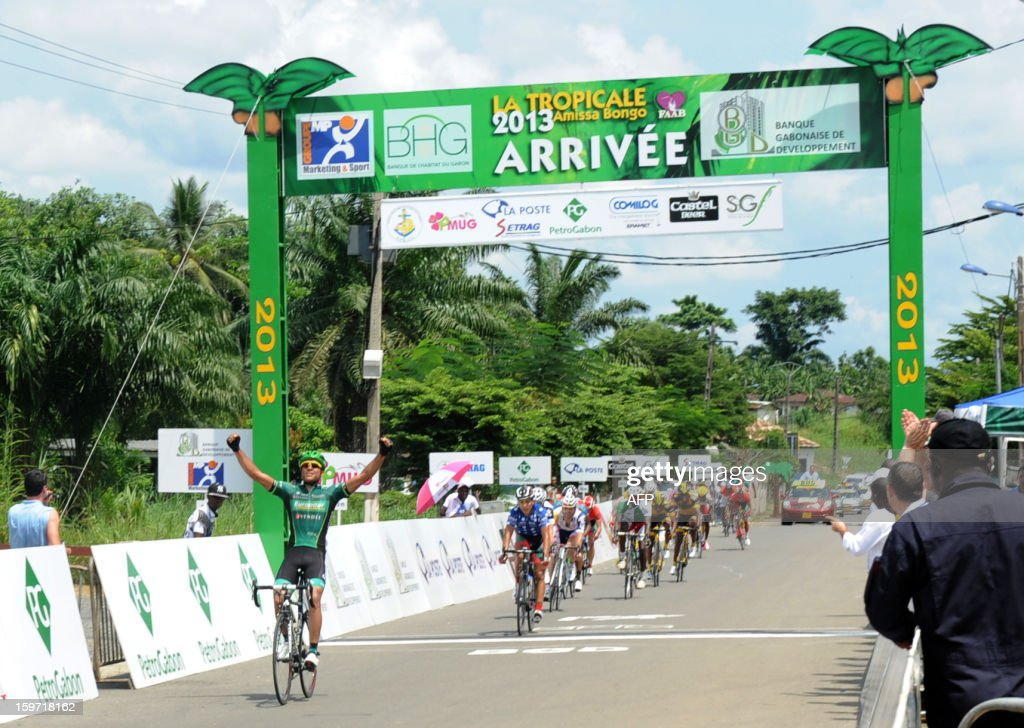 French cyclist Yohann Gene (L) of the Europcar team crosses on January 19, 2013 in Kango the finish line to win the sixth, 147 kms stage of the eighth edition of the Tropicale Amissa Bongo cycling race between Lambarene and Kango in western Gabon. AFP PHOTO / STEVE JORDAN