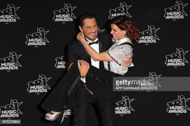 French dancer and TV host Fauve Hautot and French TV host Vincent Cerutti pose upon their arrival to attend the 19th NRJ Music Awards at the Palais...