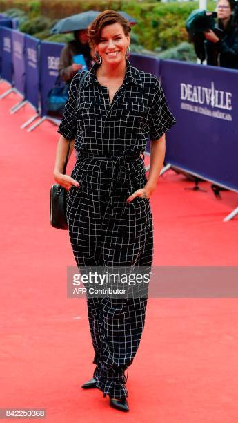 French dancer Fauve Hautot poses as she arrives for the screening of the film 'Kidnap' during the 43rd Deauville US Film Festival in the northwestern...