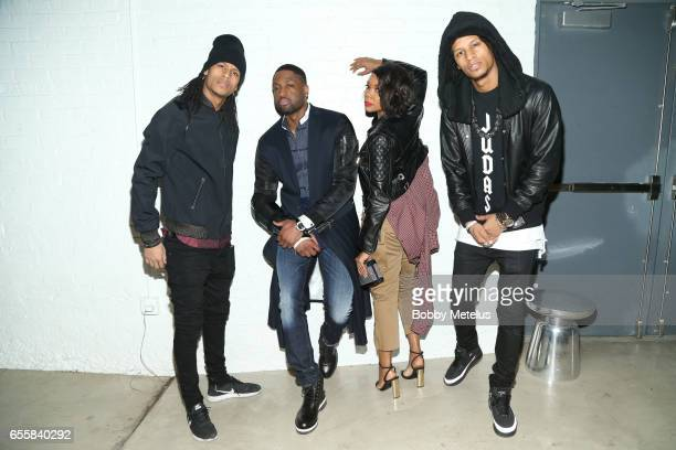 French Dancers Les Twins Gabrielle Union and Dwyane Wade strike a pose together backstage at the A Night on the Runwade Fashion Event at Revel Fulton...