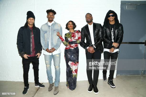 French Dancers Les Twins Jimmy Butler Gabrielle Union and Dwyane Wade strike a pose together backstage at the A Night on the Runwade Fashion Event at...