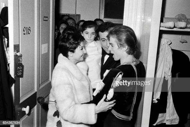 French danser Zizi Jeanmaire her husband French choreographer Roland Petit and their daughter Valentine congratulate Soviet ballet dancer Rudolf...