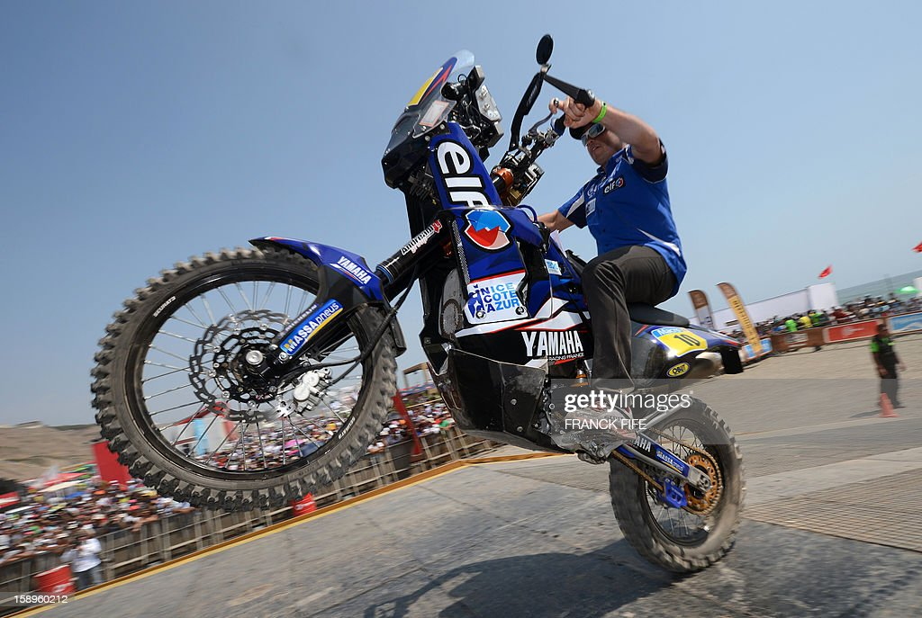 French David Casteu is pictured on the podium in Lima on January 4, 2013, ahead of the 2013 Dakar Rally which this year will thunder through Peru, Argentina and Chile from January 5 to 20. AFP PHOTO / FRANCK FIFE