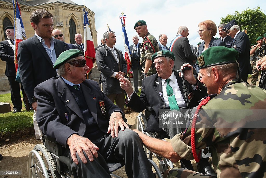 French D-Day veterans, including Leon Gautier (C), attend a wreath-laying ceremony for members of the Troop One unit of free French commandos under Lieutenant Phlippe Kiefer who landed at Sword Beach during the World War II D-day invasion on June 7, 2014 in Ranville, France. Friday the 6th of June is the 70th anniversary of the D-Day landings that saw 156,000 troops from the Allied countries, including the United Kingdom and the United States, join forces to launch an audacious attack on the beaches of Normandy, these assaults are credited with the eventual defeat of Nazi Germany. A series of events commemorating the 70th anniversary are planned for the week with many heads of state travelling to the famous beaches to pay their respects to those who lost their lives.