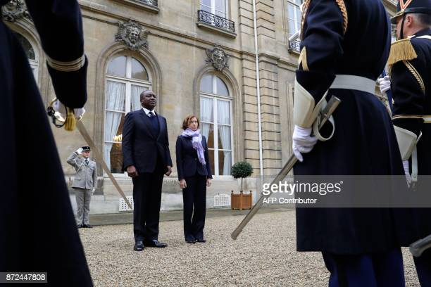 French Defence Minister Florence Parly and Ivory Coast's Defence Minister Hamed Bakayoko review the Honor Guard on November 10 at the French Ministry...