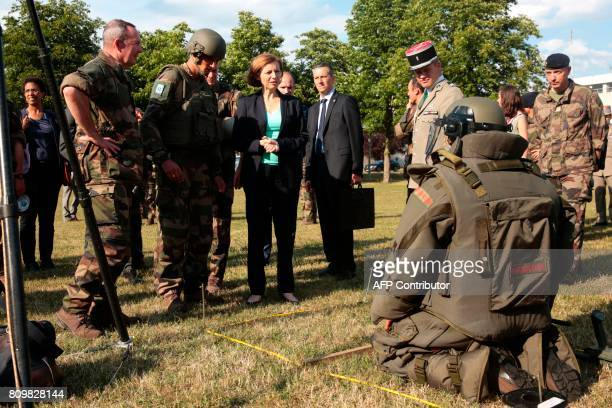French Defence minister Florence Parly attends a mine clearance operation during a visit to the Satory military camp in Versailles southwest of Paris...