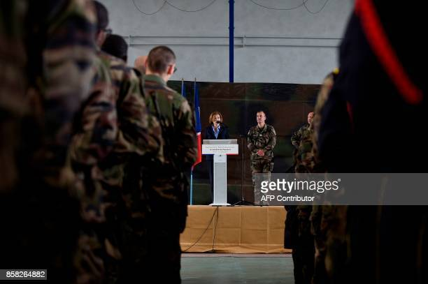 French Defence Minister Florence Parly flanked by Colonel Francois Mariotti commanding officer of the batallion speaks as she visits the 16eme...
