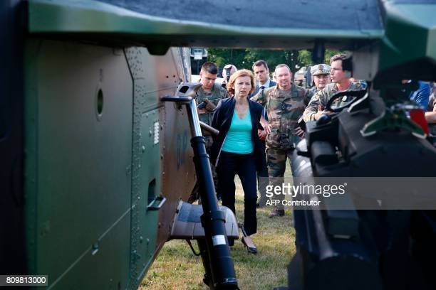 French Defence minister Florence Parly looks at a Tigre helicopter during a visit to the Satory military camp in Versailles southwest of Paris on...