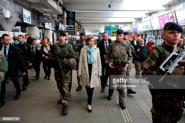 French Defence Minister Florence Parly speaks with French soldiers of the Sentinelle military force security mission during a visit to meet them at...