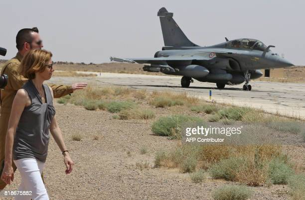 French Defence Minister Florence Parly stands in front of a French Rafale fighter jet during a visit to a military base in Jordan on July 18 2017 /...