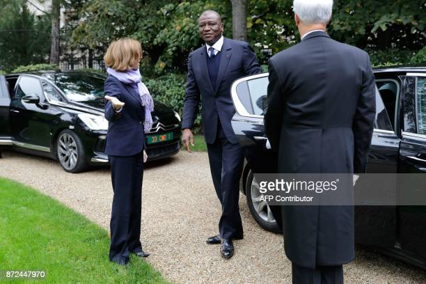 French Defence minister Florence Parly welcomes Ivory Coast's Defence Minister Hamed Bakayoko as he arrives for a meeting on November 10 at the...