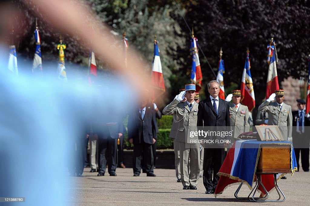French Defence minister Gerard Longuet (3rdR) stands in front of the coffin of French lieutenant Camille Levrel, on August 19, 2011 in Colmar, eastern France, during his funeral ceremony. Levrel, a 36-year-old officer who had also served in Kosovo and Chad, was shot dead in the northeastern Afghanistan region of Kapisa on August 14, 2011. The lieutenant's death, which took place during a support mission for the national Afghan forces, brings to 74 the number of French soldiers killed in Afghanistan since 2001