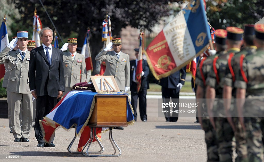 French Defence minister Gerard Longuet (2ndL) stands in front of the coffin of French lieutenant Camille Levrel, on August 19, 2011 in Colmar, eastern France, during his funeral ceremony. Levrel, a 36-year-old officer who had also served in Kosovo and Chad, was shot dead in the northeastern Afghanistan region of Kapisa on August 14, 2011. The lieutenant's death, which took place during a support mission for the national Afghan forces, brings to 74 the number of French soldiers killed in Afghanistan since 2001