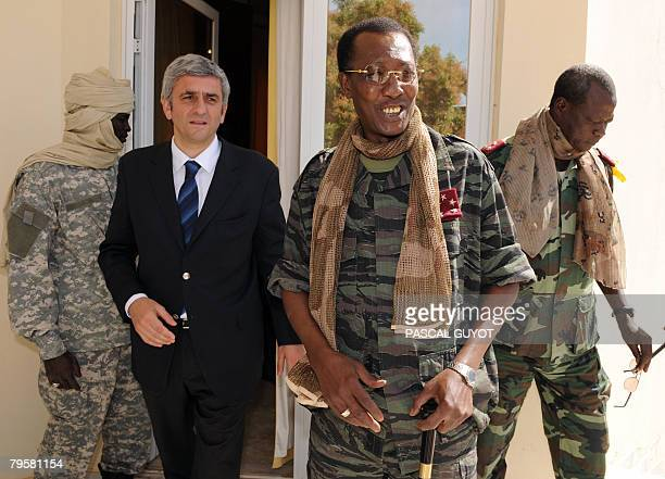 French Defence Minister Herve Morin is accompanied by Chadian President Idriss Deby Itno on February 6 2008 in Ndjamena during an official visit to...