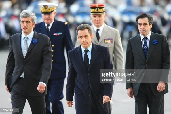 French Defence Minister Herve Morin President Nicolas Sarkozy and Prime Minister Francois Fillon arrive at the Arc de Triumph to attend the Armistice...