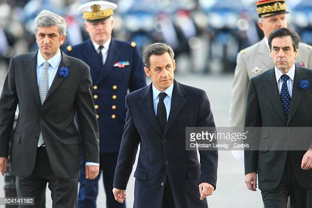 French Defence Minister Herve Morin President Nicolas Sarkozy and Prime Minister Francois Fillon arrive at the Arc de Triumphe to attend the...