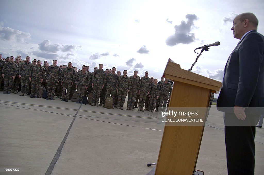 French Defence Minister, Jean-Yves Le Drian (R) addresses French soldiers Paphos airport in Cyprus in December 8, 2012 before leaving for France. Le Drian today welcomed some 150 French soldiers returning from Afghanistan.