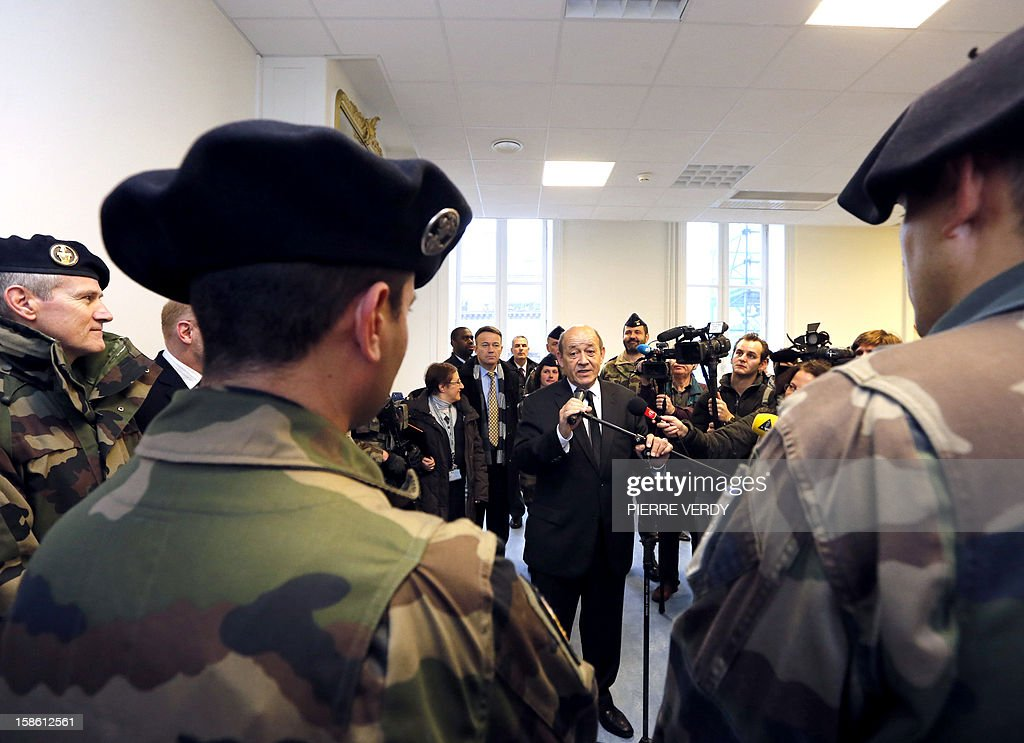French Defence minister Jean-Yves Le Drian adresses security forces deployed on December 21, 2012 at Gare du Nord railway station in Paris as France's national security alert system 'Plan Vigipirate' is reinforced for the Christmas holidays .
