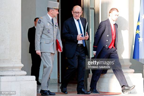 French Defence minister JeanYves Le Drian and Chief of the Defence Staff French army General Pierre de Villiers leave after a meeting of the Defense...