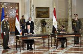French Defence minister JeanYves Le Drian and Egyptian Defence Minister General Sedki Sobhi sign military contracts in the presence of Egyptian...