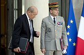 French Defence minister JeanYves Le Drian and French Army Chief of Staff General Pierre de Villiers leave the Elysee palace on October 1 in Paris...