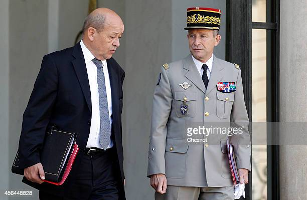 French Defence minister JeanYves Le Drian and French Army Chief of Staff General Pierre de Villiers leave the Elysee palace after an extraordinary...